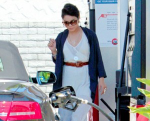 Vanessa  Hudgens pumping gas in  Los Angeles, CA.
